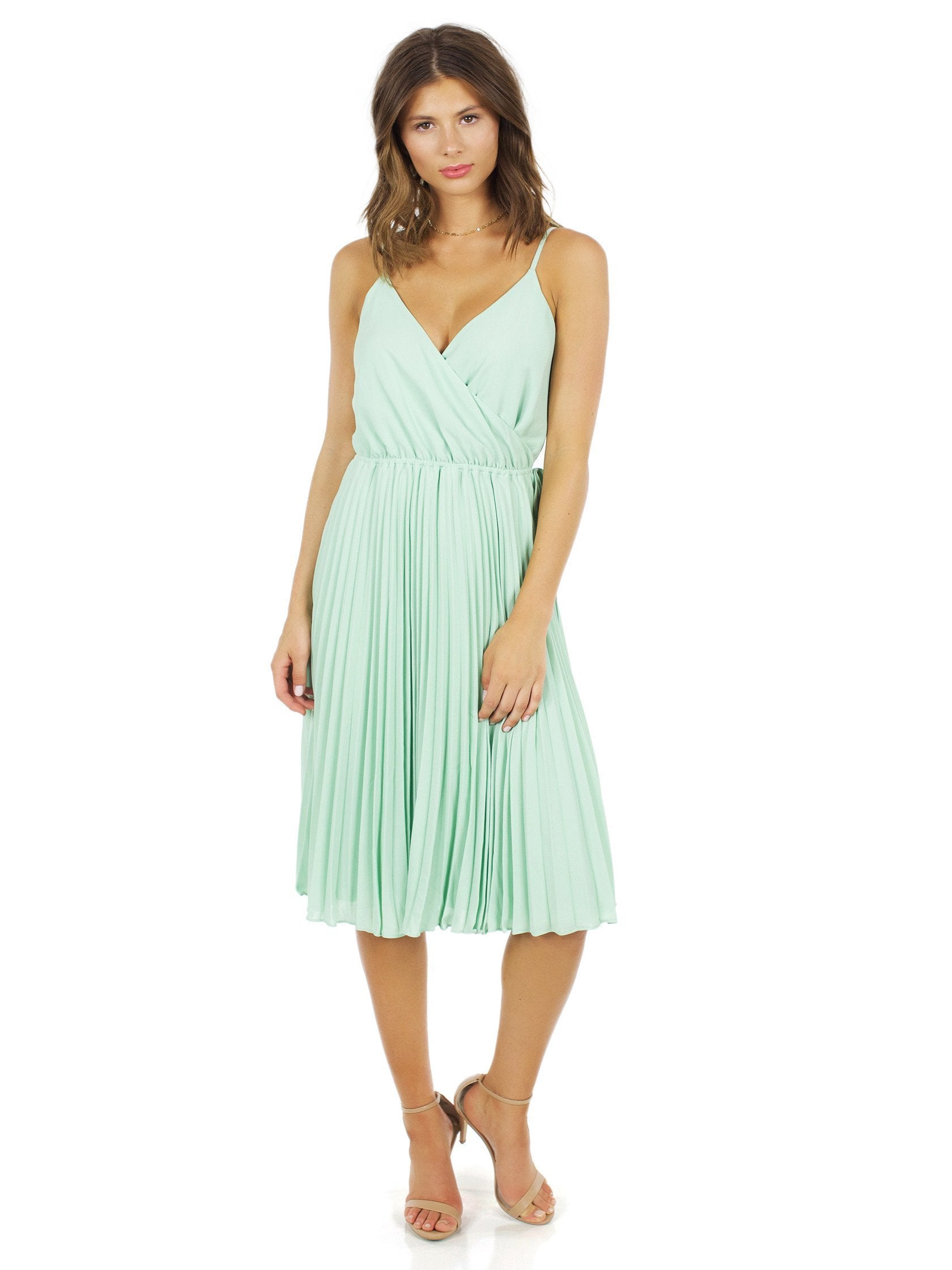 Woman wearing a dress rental from Ali & Jay called Lily Pond Fit & Flare Dress