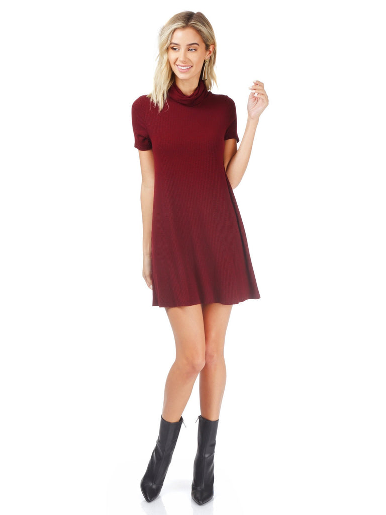 Girl wearing a dress rental from AQUA called Velvet Burnout Mock Dress