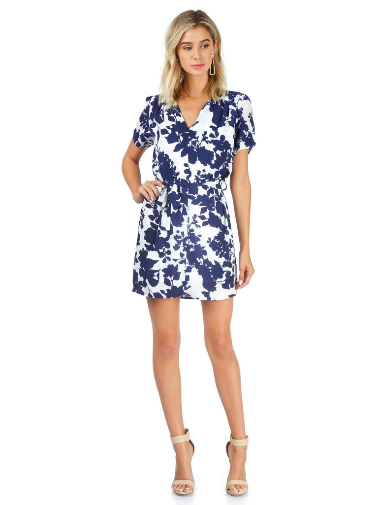 Women wearing a dress rental from AQUA called All My Love Midi Wrap Dress