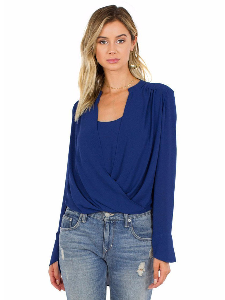 Women wearing a top rental from BCBGMAXAZRIA called Jaklyn Draped-front Blouse