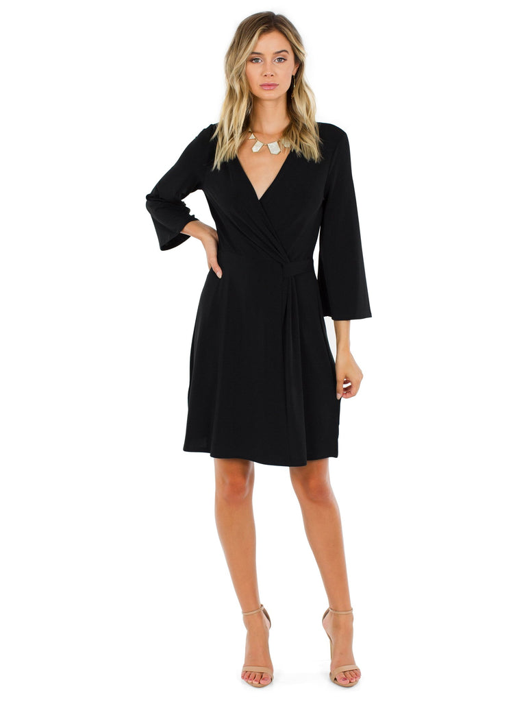 Women wearing a dress rental from BCBGMAXAZRIA called Adelene Faux-suede Dress
