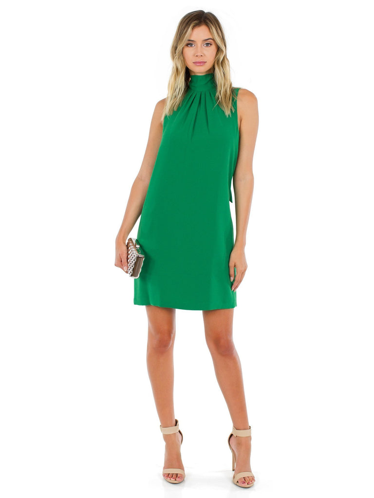 Woman wearing a dress rental from BCBGMAXAZRIA called Velvet Burnout Mock Dress