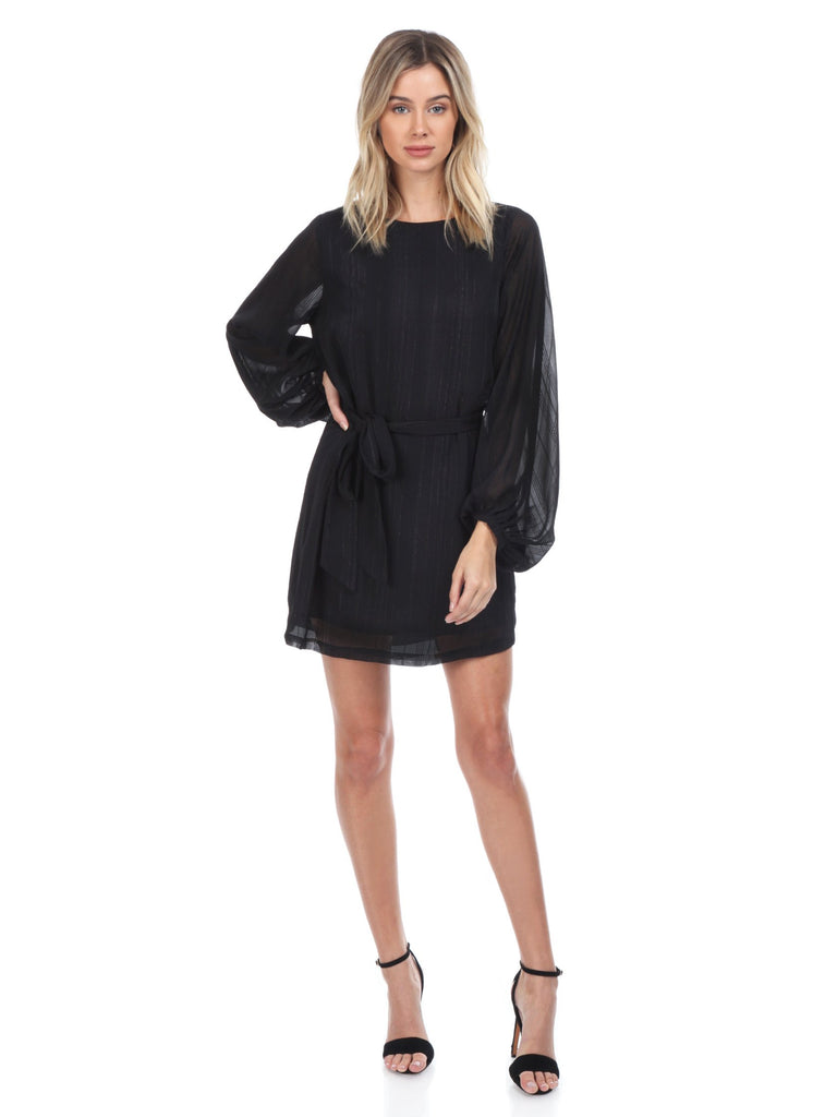 Woman wearing a dress rental from YUMI KIM called Black Drive Me Home Mini Dress
