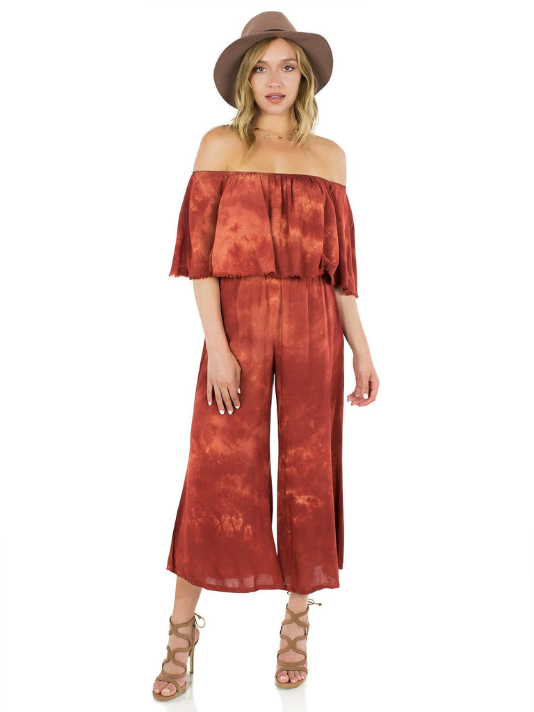 Women wearing a jumpsuit rental from Blue Life called Festive Off Shoulder Maxi