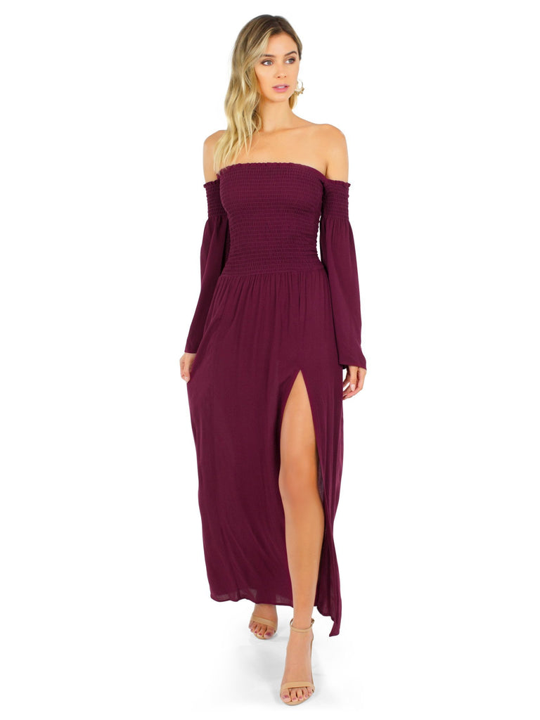 Women wearing a dress rental from Blue Life called Festive Off Shoulder Maxi
