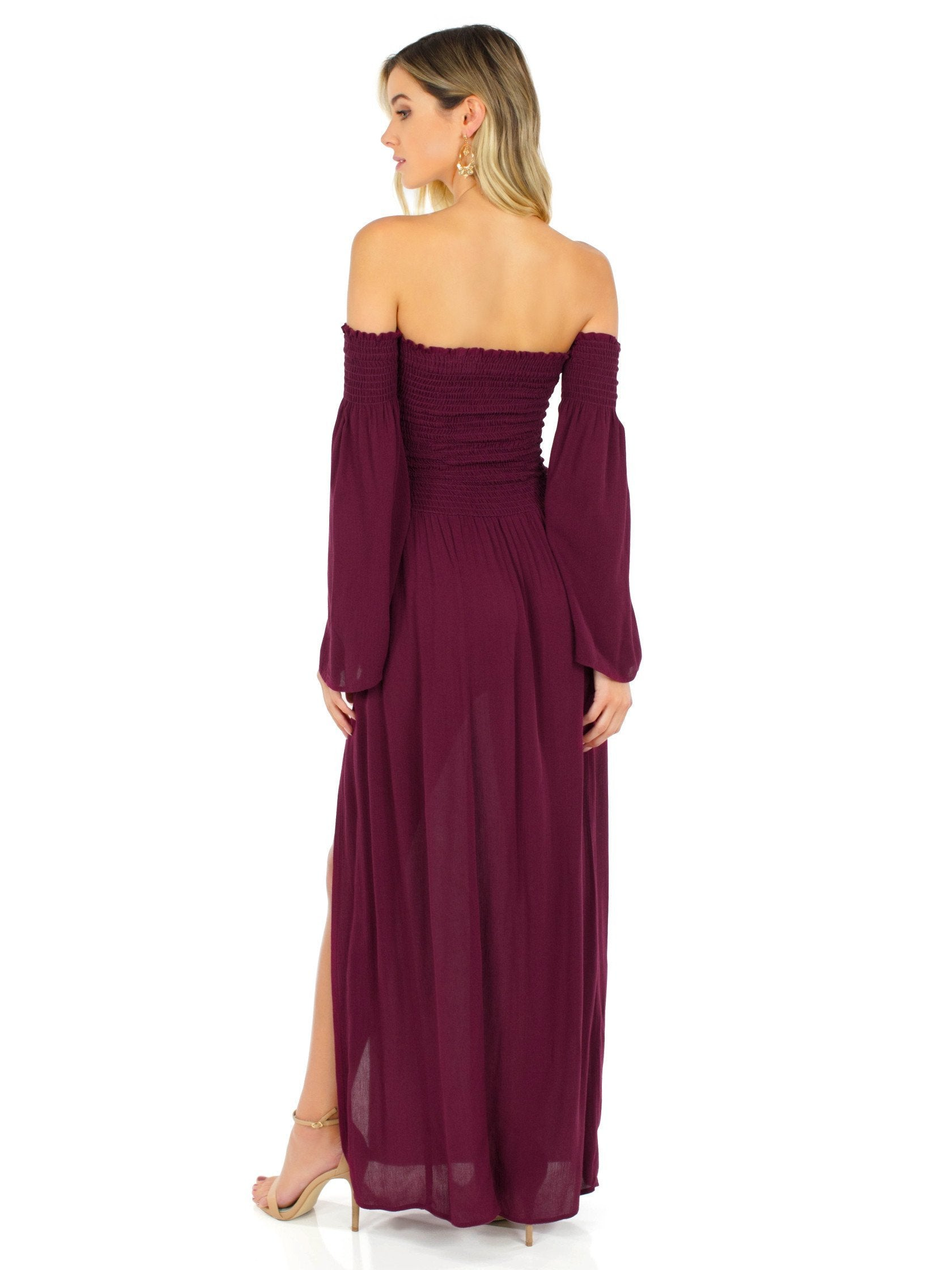 Girl outfit in a dress rental from Blue Life called Festive Off Shoulder Maxi