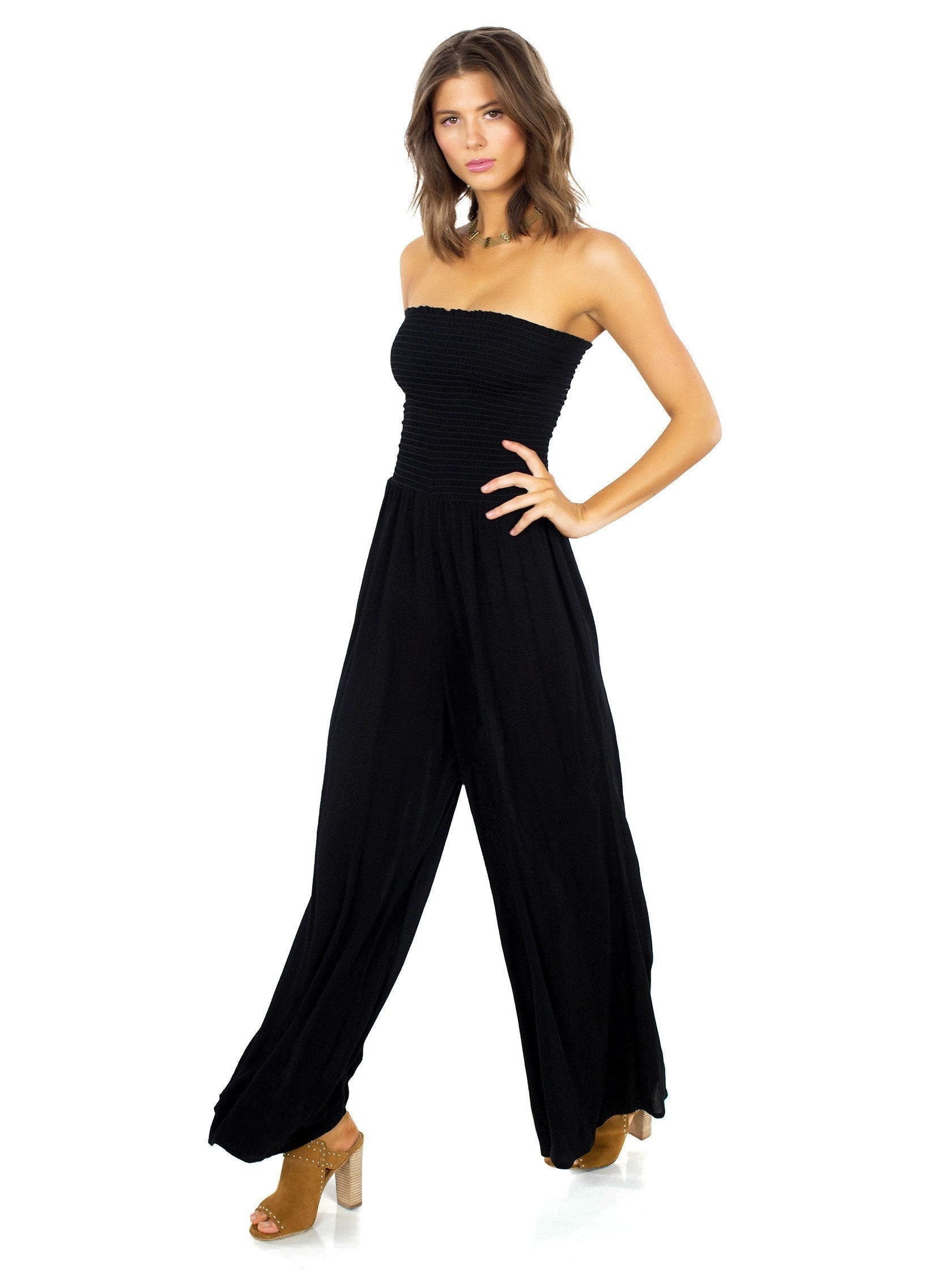 Woman wearing a jumpsuit rental from Blue Life called Smocking Bell Jumper