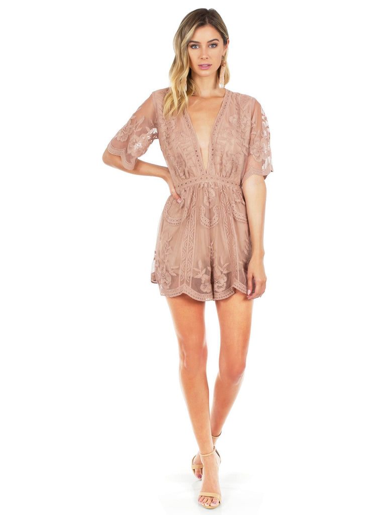 Women wearing a romper rental from FashionPass called Blossom Wrap Dress