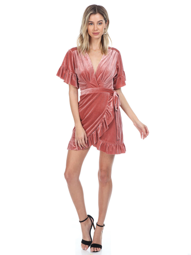 Women wearing a dress rental from FashionPass called Carolina Wrap Dress