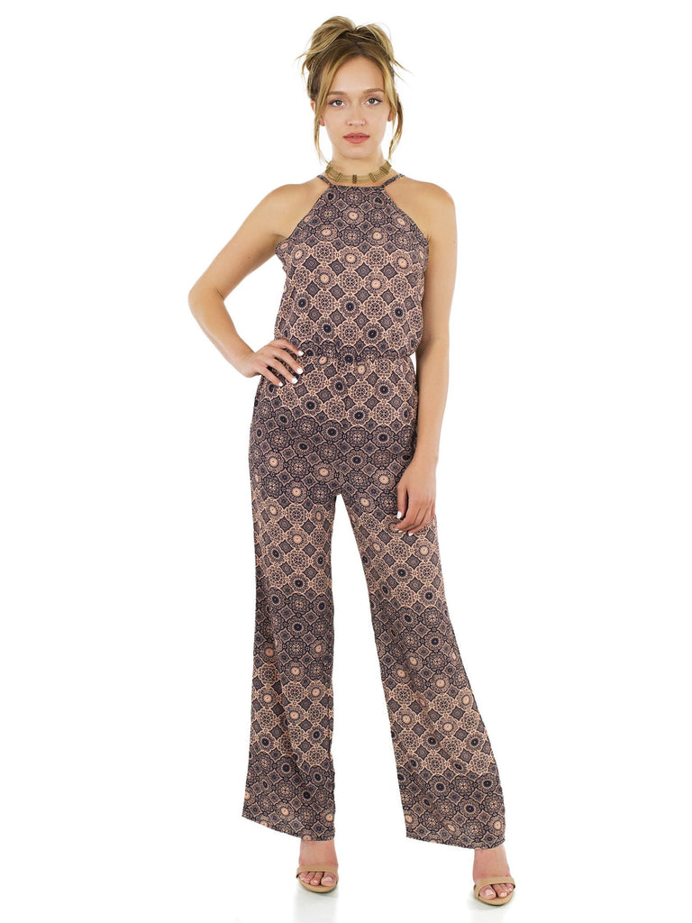 Women wearing a jumpsuit rental from FashionPass called Desert Sky Jumpsuit