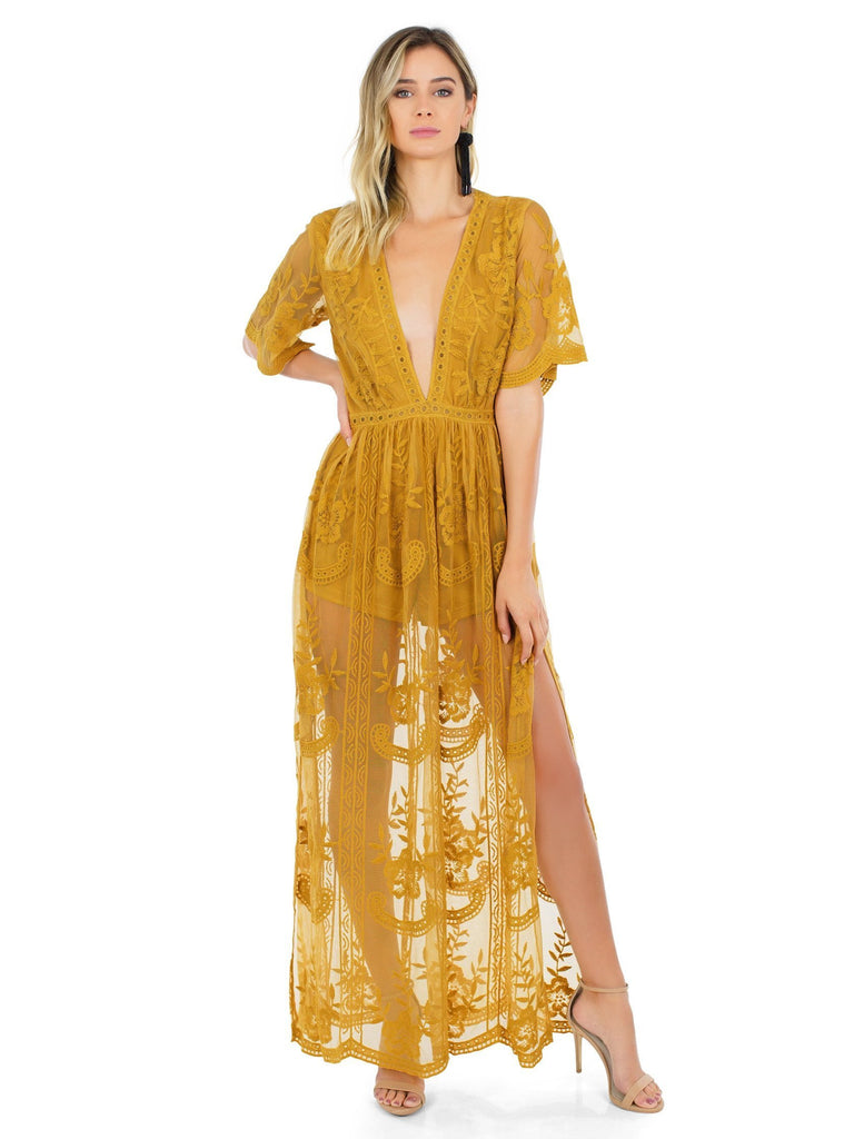 Woman wearing a romper rental from FashionPass called Kennedy Maxi Dress