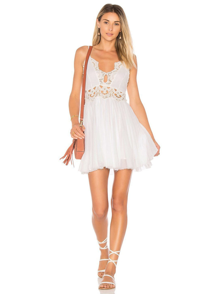 Women wearing a dress rental from Free People called Ilektra Mini Dress