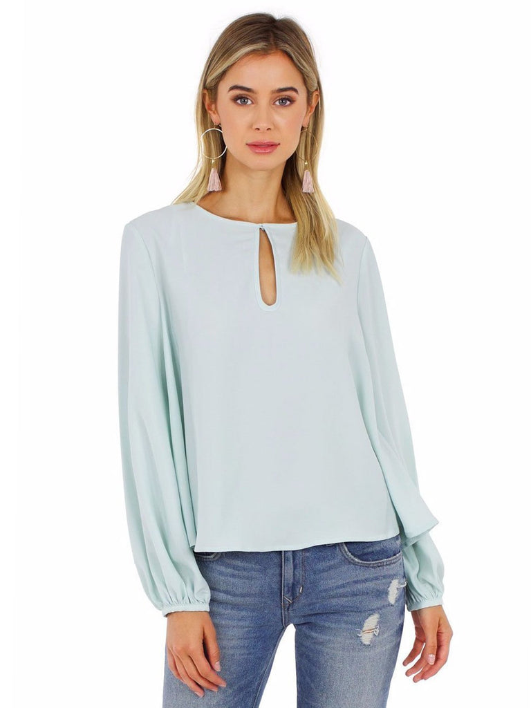 Women wearing a top rental from Grace Willow called Selena Trapeze Top