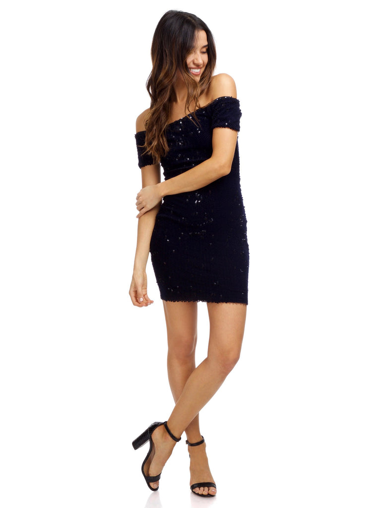 Girl wearing a dress rental from Dress the Population called Cassie Sequin Midi Dress