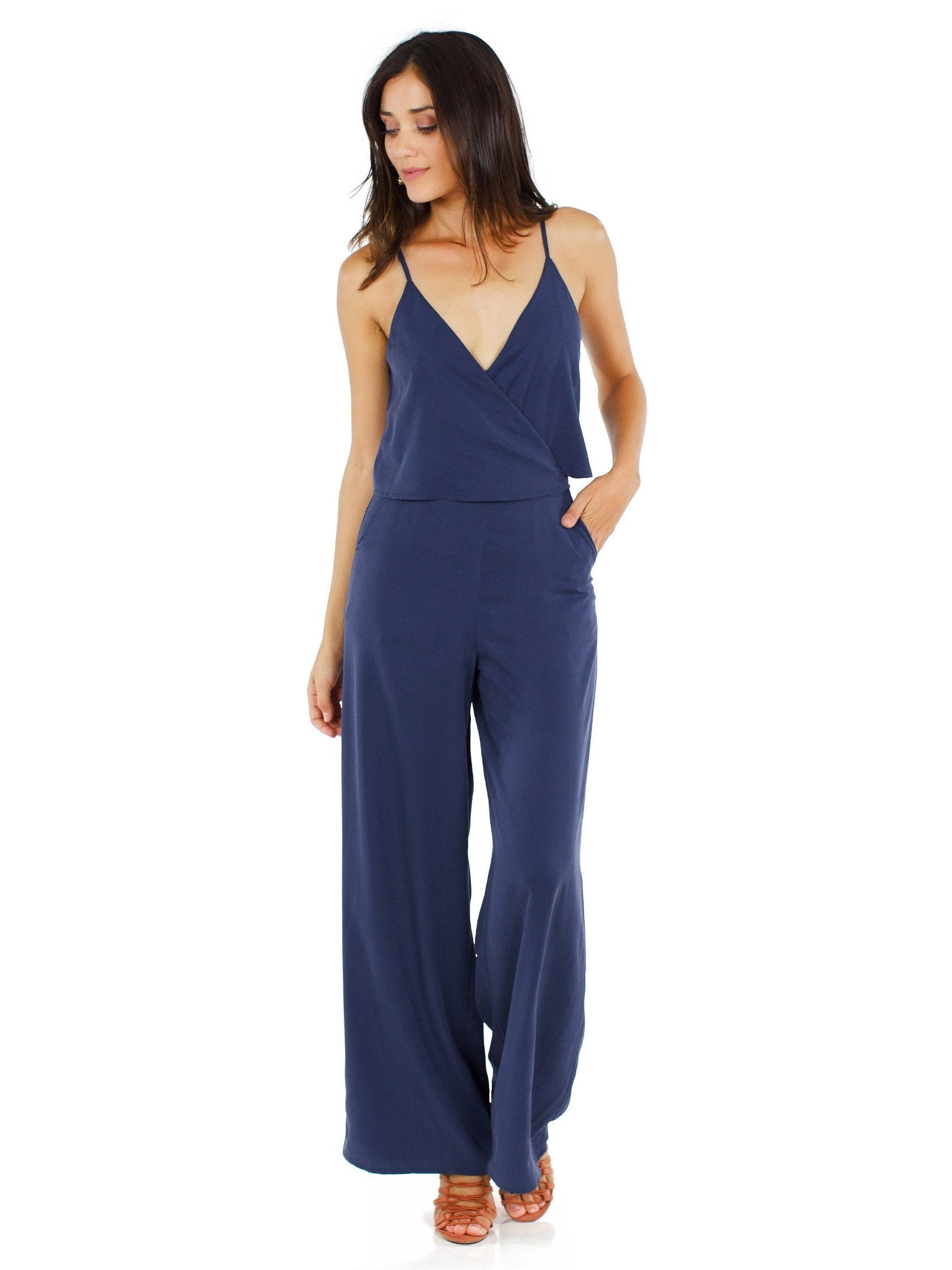 Woman wearing a jumpsuit rental from Line & Dot called Bertie Jumpsuit