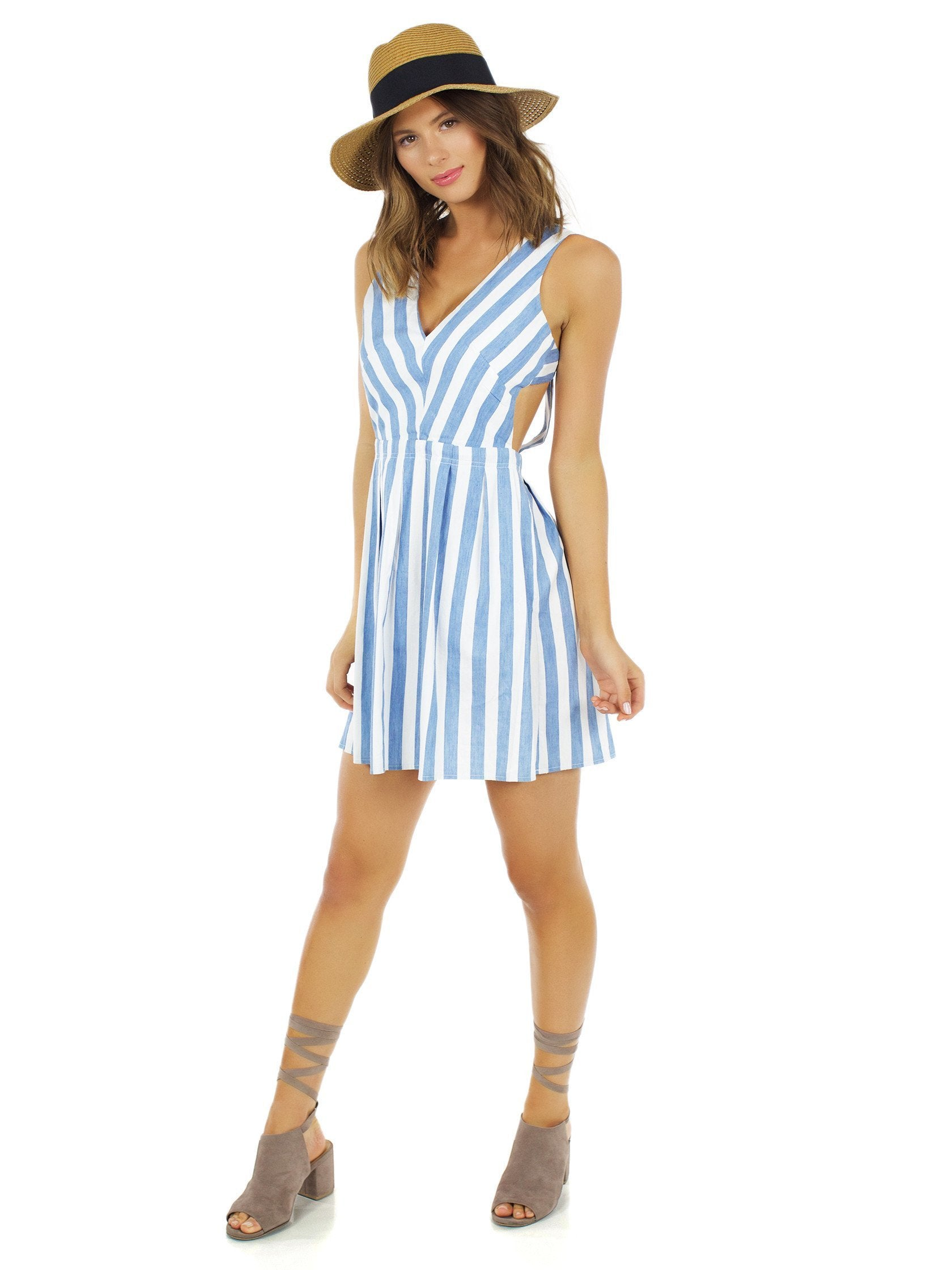 Woman wearing a dress rental from Lost In Lunar called Alexis Stripe Dress