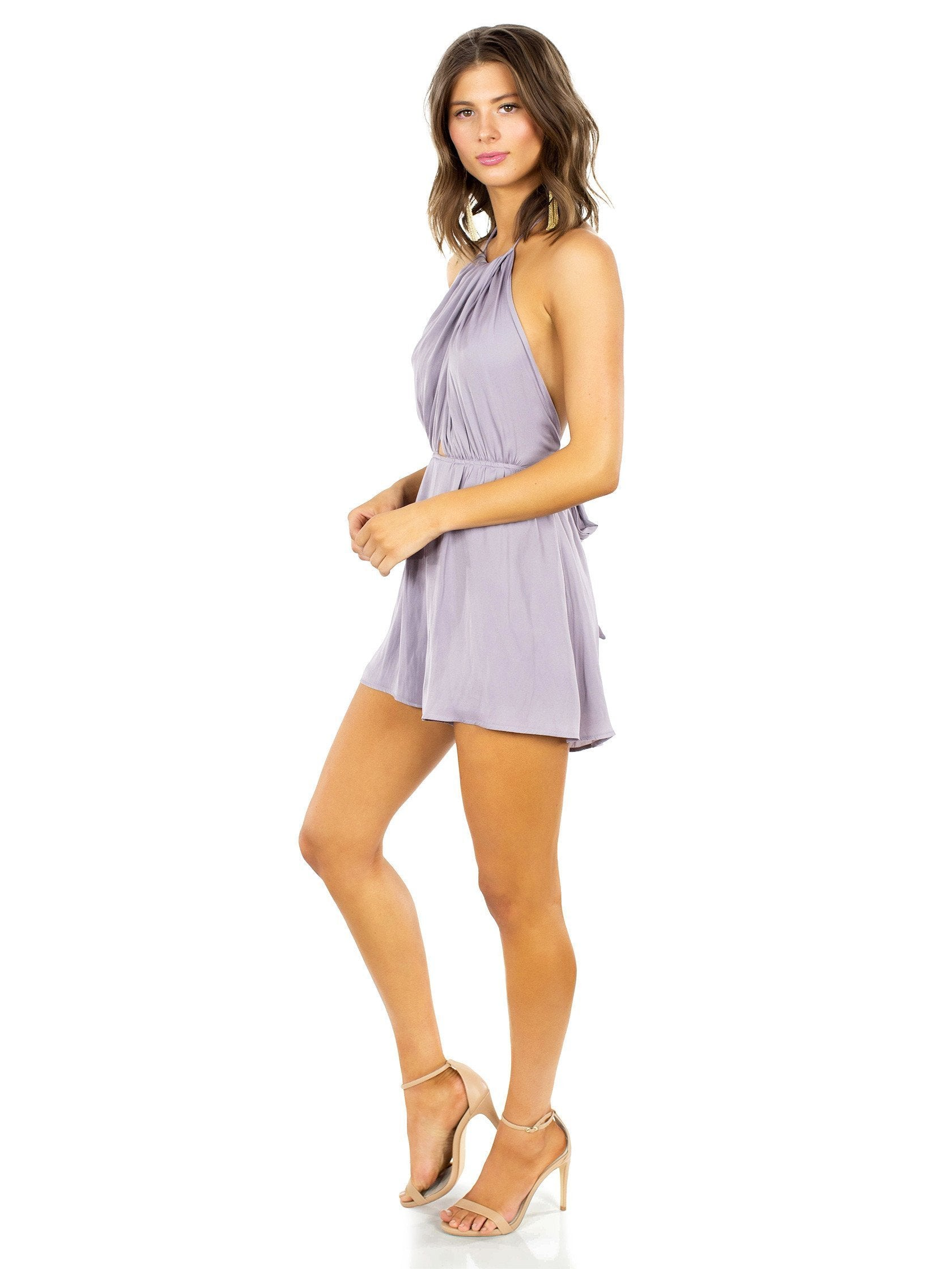 Woman wearing a romper rental from Lush called Take A Chance Romper