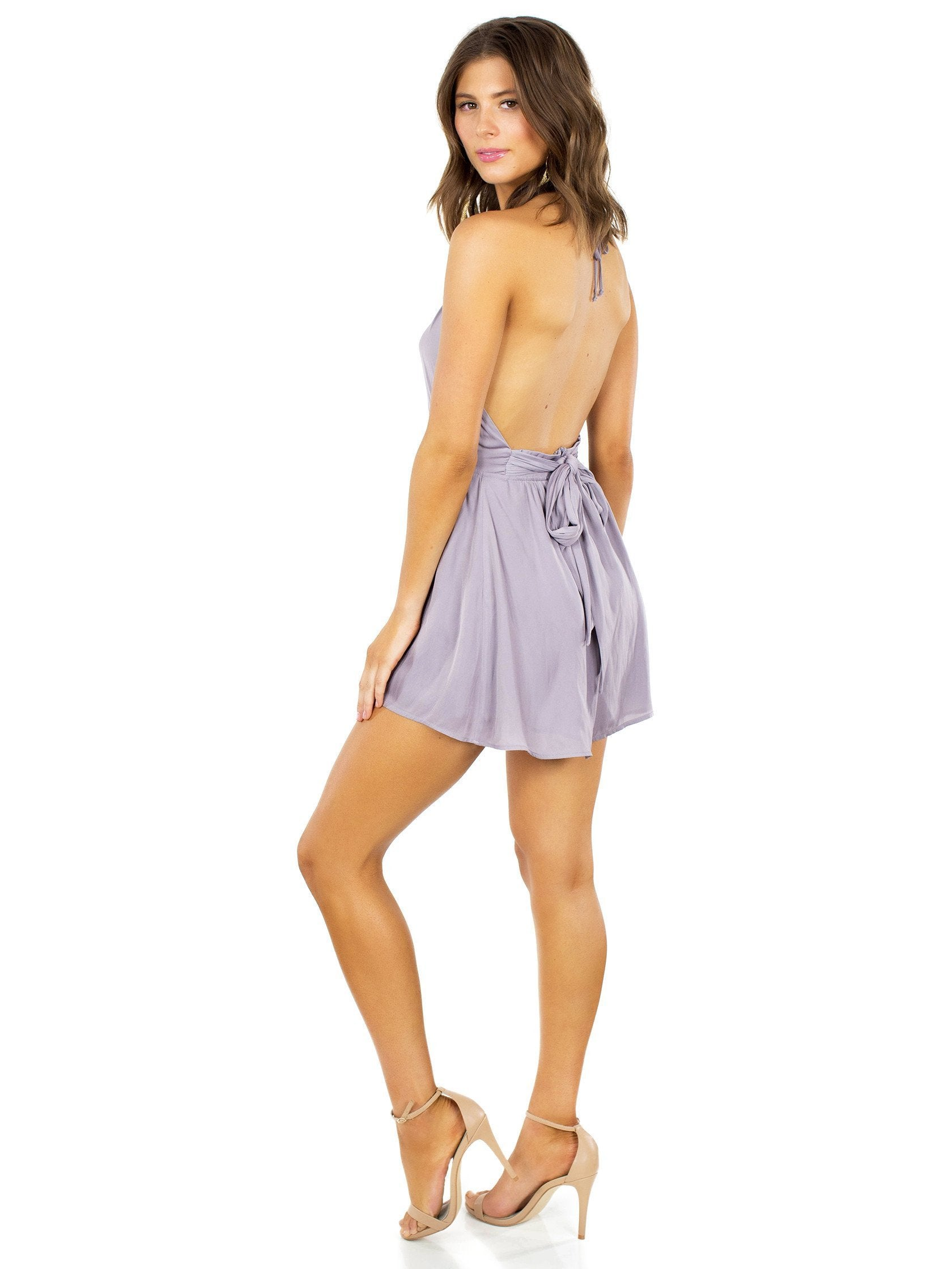 Women wearing a romper rental from Lush called Take A Chance Romper