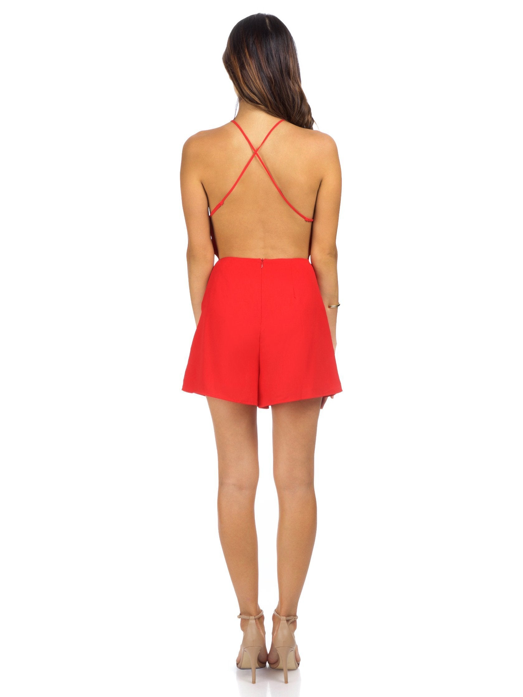 Women wearing a romper rental from Lush called Wild About You Romper