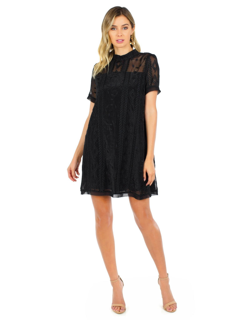 Women wearing a dress rental from Moon River called Organza Lace Dress