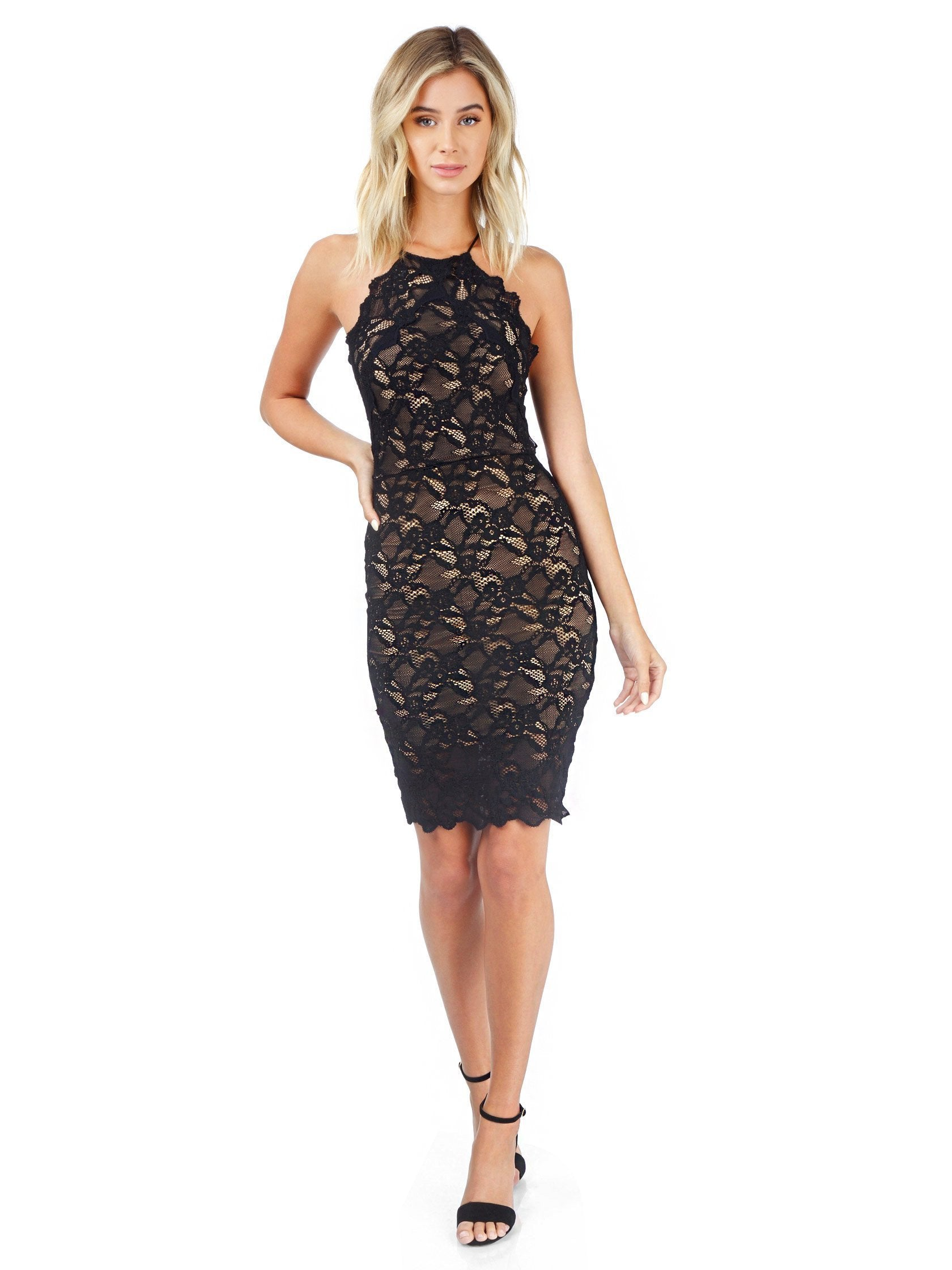 Woman wearing a dress rental from Nightcap Clothing called Black Drive Me Home Mini Dress