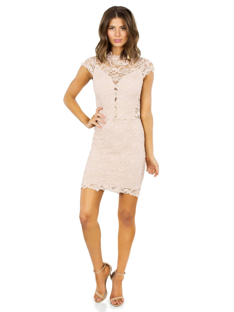 Woman wearing a dress rental from Nightcap Clothing called Blossom Wrap Dress