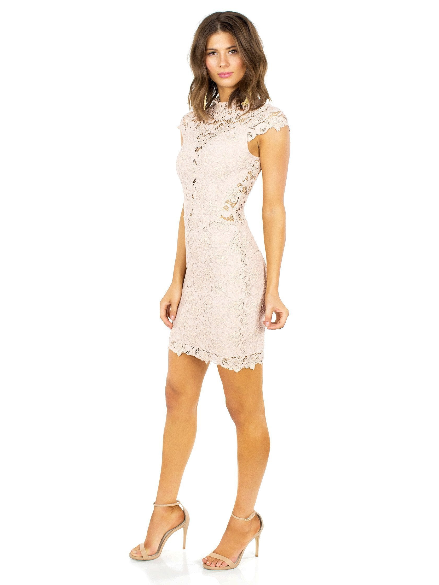 Woman wearing a dress rental from Nightcap Clothing called Dixie Lace 16th District Mini Dress