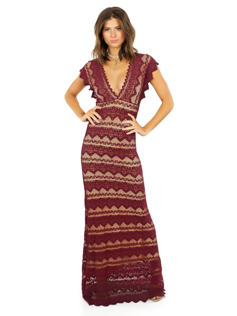Woman wearing a dress rental from Nightcap Clothing called Velvet Saskia Maxi Dress