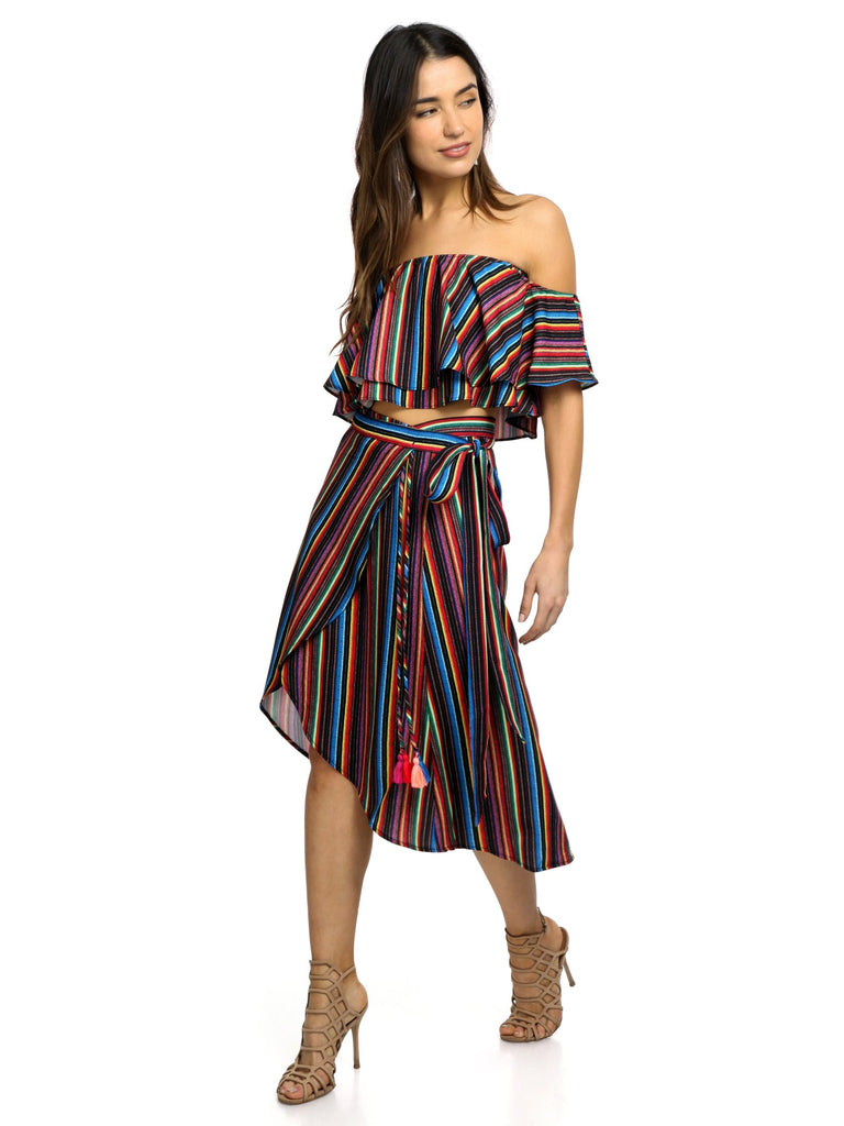 Women wearing a skirt rental from Show Me Your Mumu called Panama Tassel Wrap Skirt