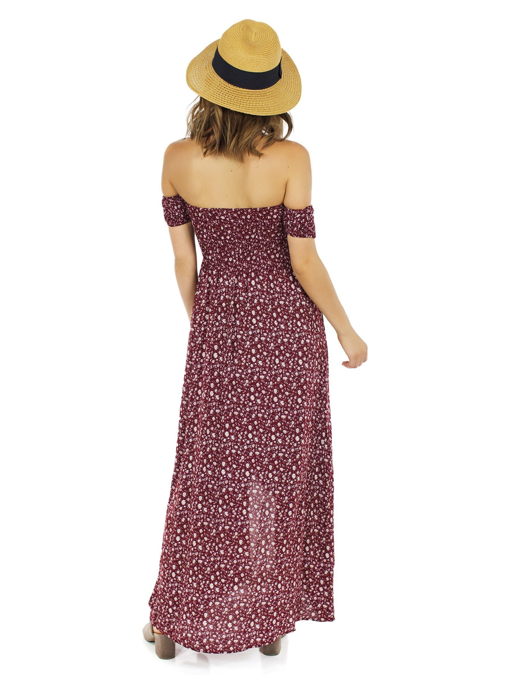 Women wearing a dress rental from Reverse called Allegra Faux Wrap Maxi Dress