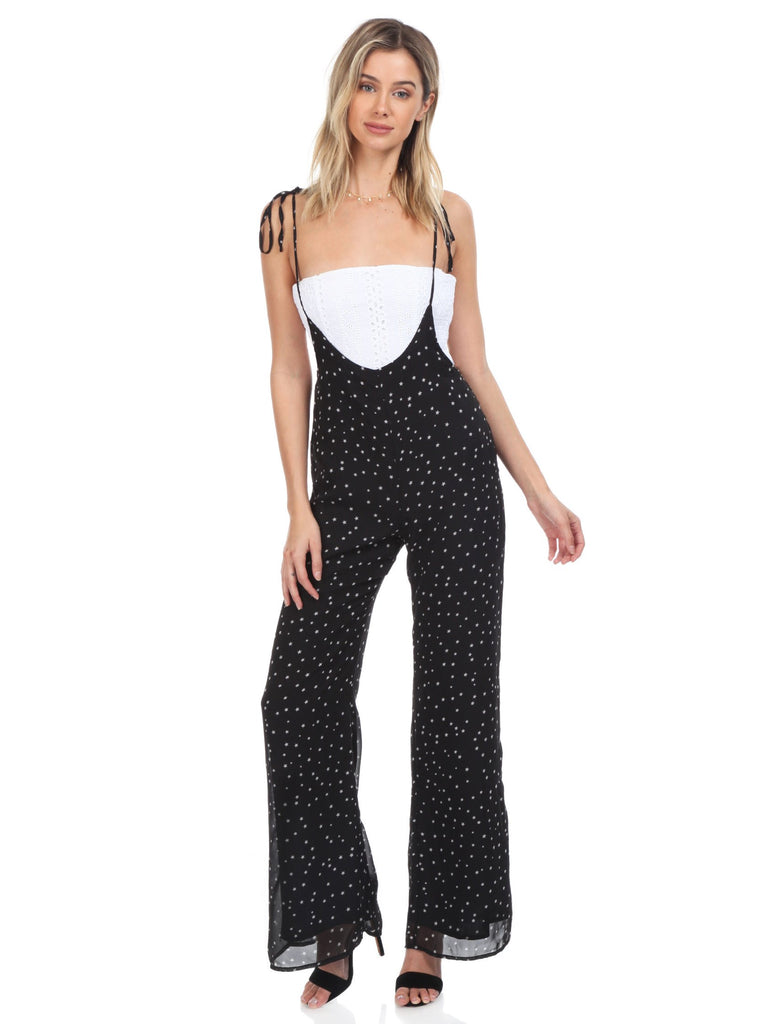 Women wearing a jumpsuit rental from FashionPass called Sasha Star Print Jumpsuit