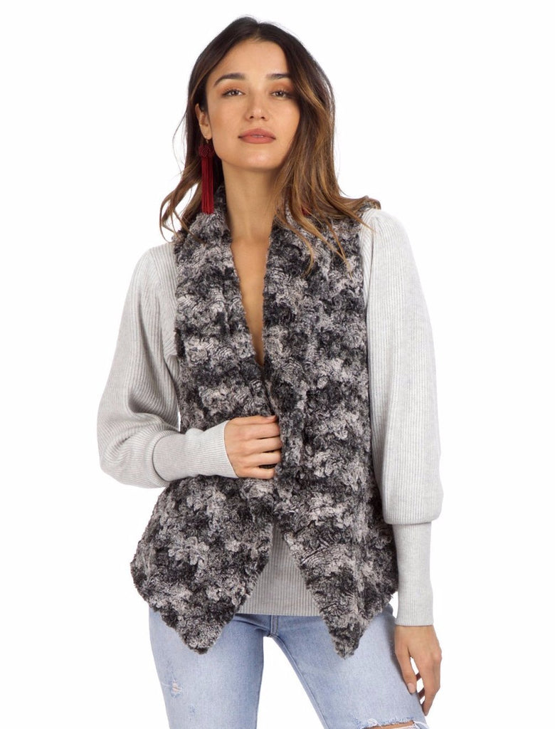 Women wearing a vest rental from Show Me Your Mumu called Fausta Vest Wolfpack Faux Fur Vest