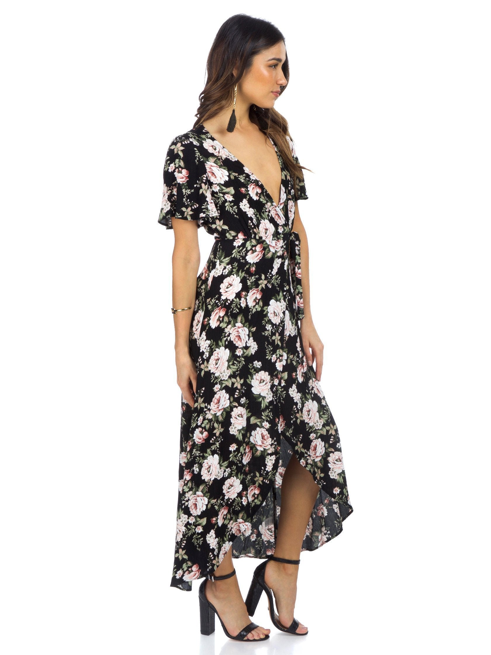 Woman wearing a dress rental from Show Me Your Mumu called Marianne Wrap Dress