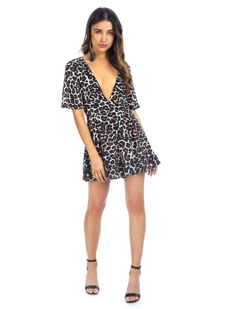 Women wearing a romper rental from Show Me Your Mumu called Tallara Romper