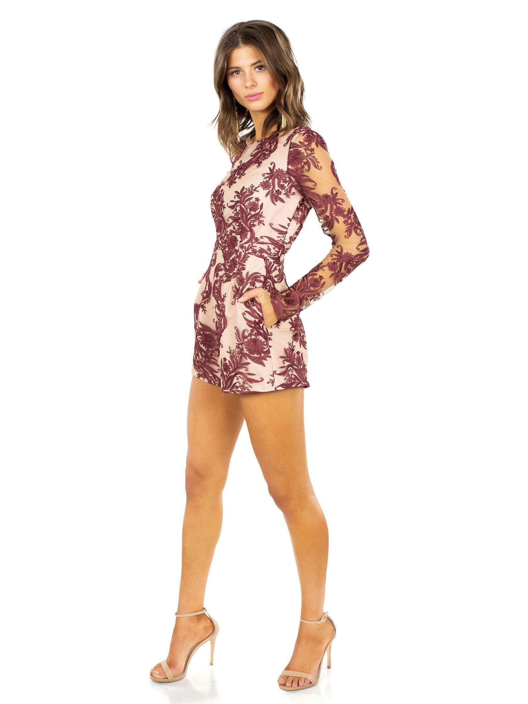 Woman wearing a romper rental from STYLESTALKER called Mehndi Ls Romper