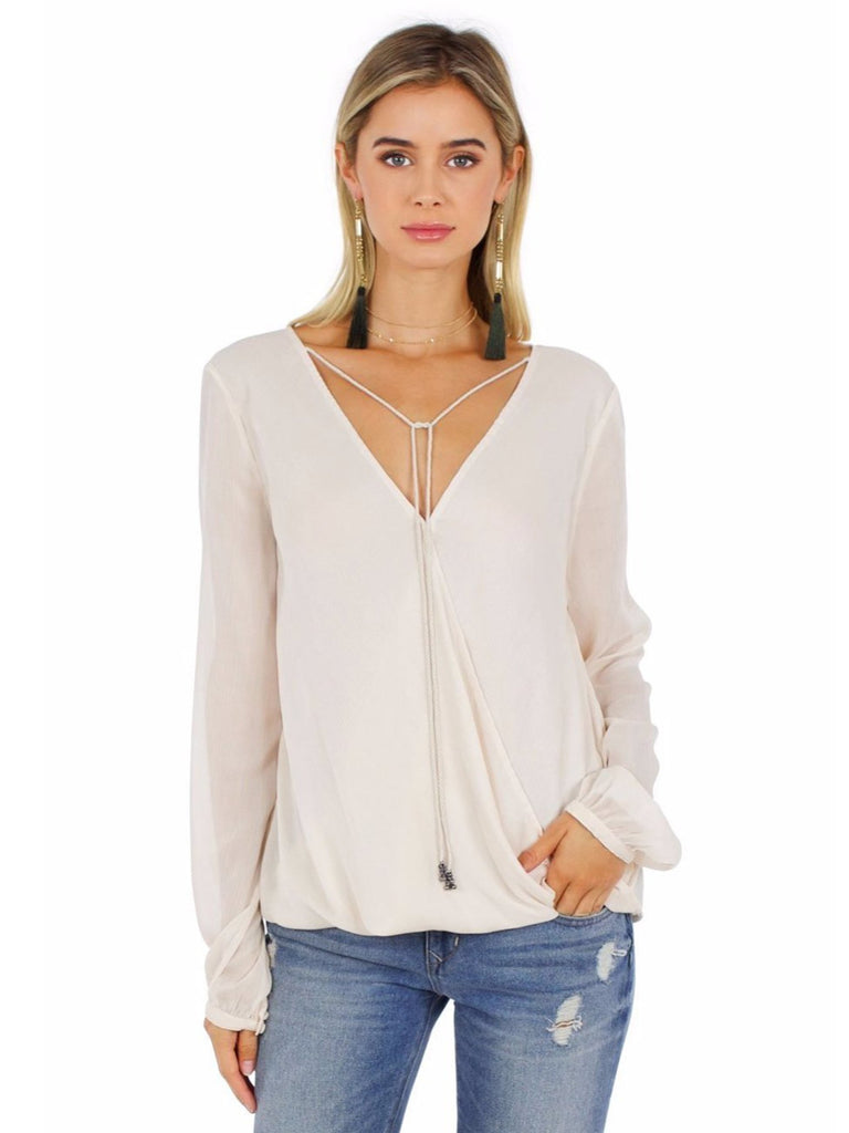 Women wearing a top rental from The Jetset Diaries called Cruise Surplice Top