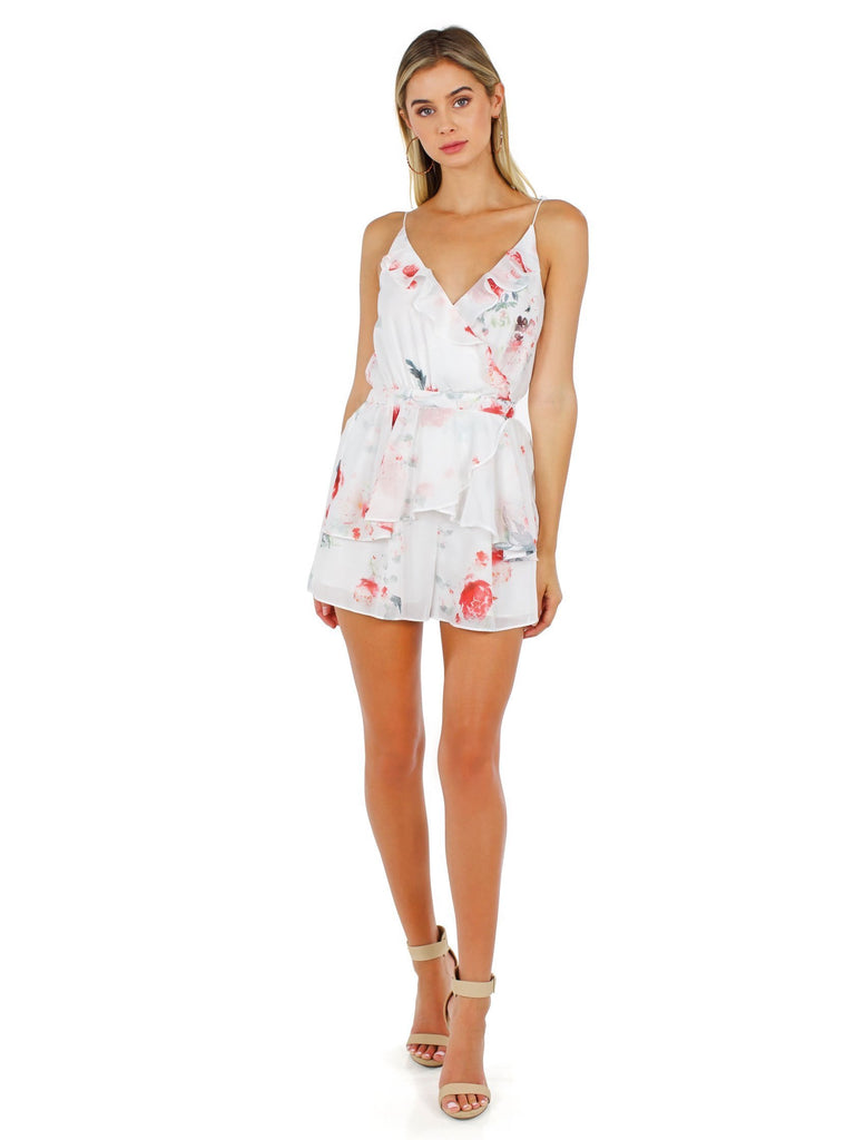 Girl wearing a romper rental from The Jetset Diaries called Aphrodite Mini Dress