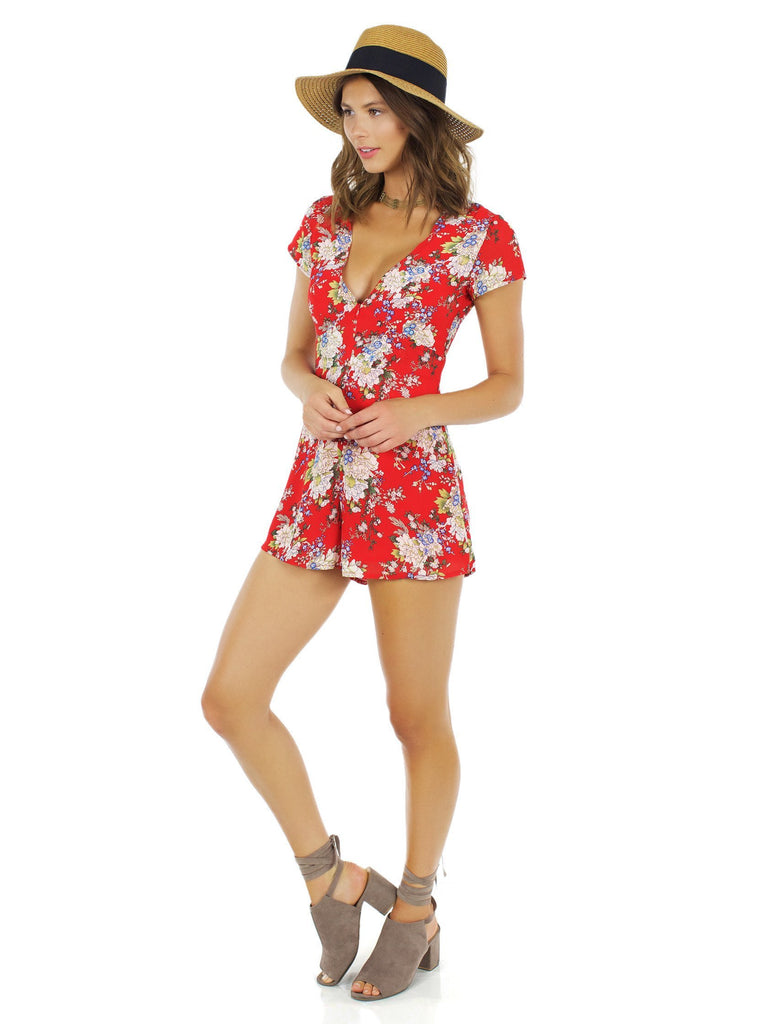 Women wearing a romper rental from WYLDR called Feel It All Playsuit