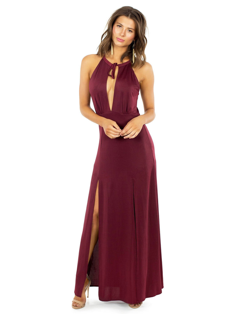 Woman wearing a dress rental from WYLDR called Allegra Faux Wrap Maxi Dress