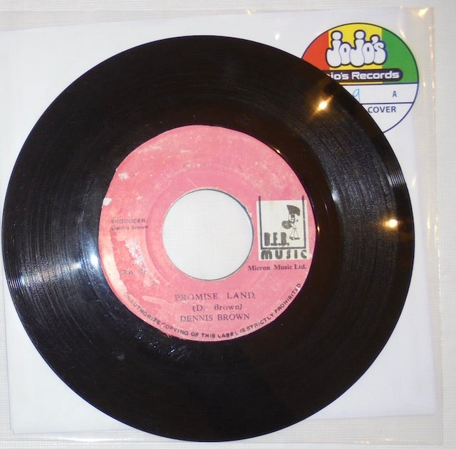 "Dennis Brown ‎– Promise Land / Version 7"" - D.E.B. Music"
