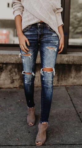 The Leah Mid Rise Distressed Skinny Denim Jeans