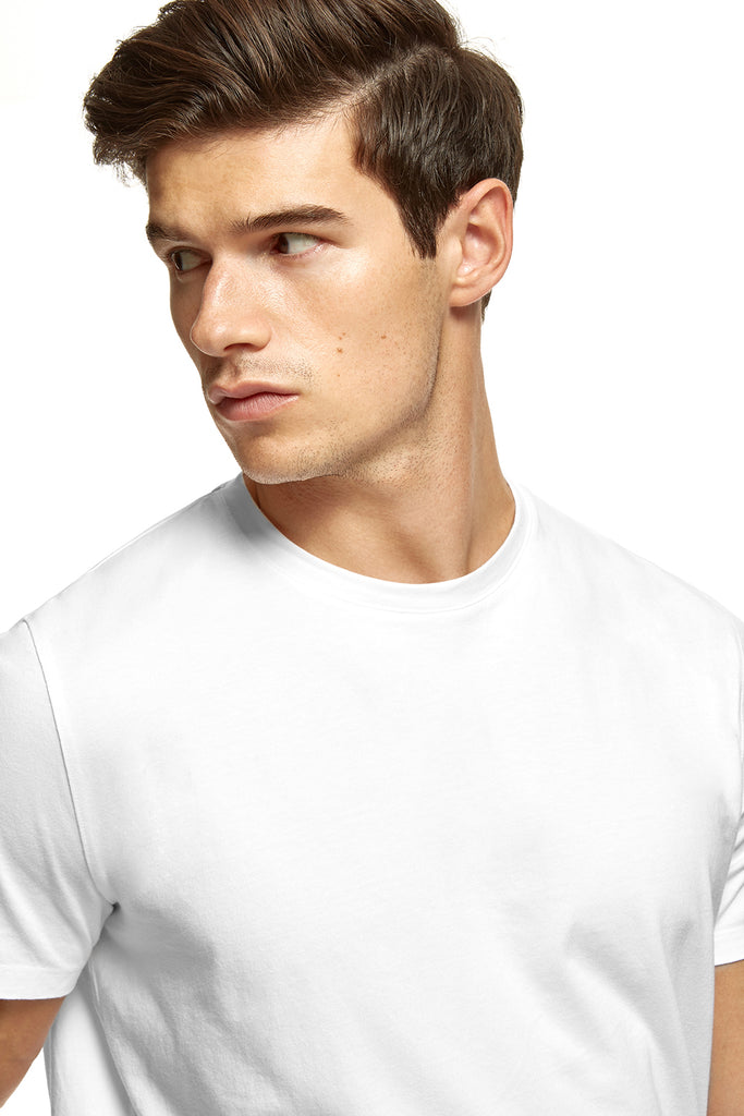 clothPROJECT model wearing men's white ethical sustainable luxury 100% cotton t-shirt with free delivery