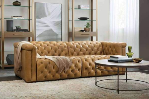 brown leather sofa with blanket