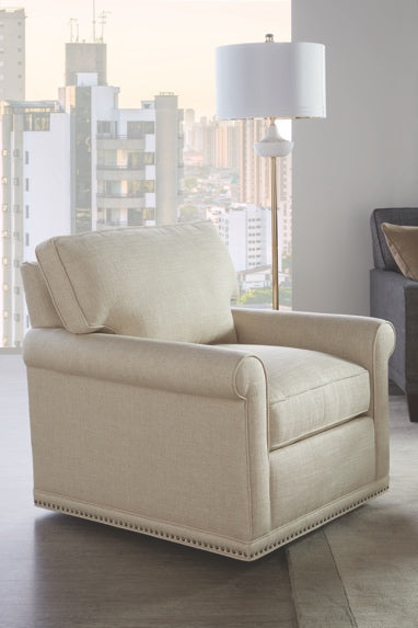 white armchair in front of large window