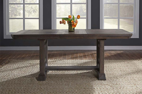 Zander Transitional 7 Piece Trestle Table Dining Set With Aged Oak Finish And Upholstered Side Chairs