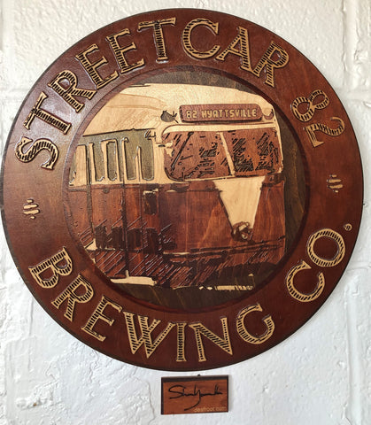 Image of Wooden sign of Streeetcar 82 Logo