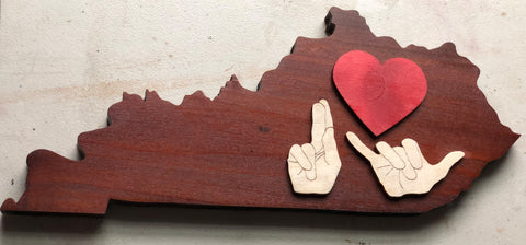 "Picture of Kectucky shape wood with heart and handshapes ""K Y"" on top"