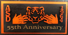 "Wooden magnet of ASD Tiger with hand ""tiger"" and engraved ""55th Anniversary"" at the bottom"