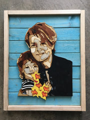 Woodcut pictur e of mother holding little girl and flowers