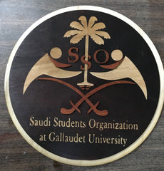 Wooden Sign of Saudi Students Organization at Gallaudet University and SSO Logo